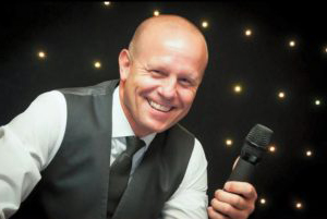 Compere Mark Tolliss